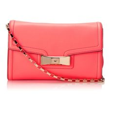 """13.HP Kate Spade Coral Bag (NWT) Make a surprise coral statement with this gorgeous Kate Spade Carroll Park Scarlette bag! 14-karat gold plated hardware, flap closure with magnetic snap, metallic jacquard polka dot lining, gold chain shoulder strap. Bifurcated interior with zip compartment and two slide pockets. 6.5""""H x 10""""W x 3.5""""D. Brand new with tag (NWT)! kate spade Bags"""