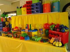 lego cake, spell names with legos, paper towl rolls and wrapped boxes for decorations... amazing treat table