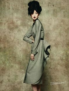 #1 Lili Ji for L'Officiel China Sep 2010 model wears a modern day bustle from the Romantic Period.