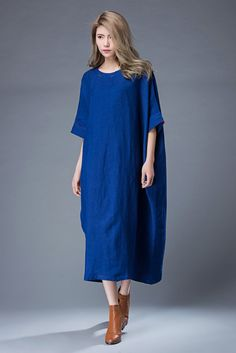 Wear this gorgeous cobalt blue loose fit tunic dress whilst admiring sunsets or swaying to live bands latr into the evening. Casual and comfortable yet very stylish, this is the perfect item to take on vacation. Youll not only be able to wear it as a beach cover-up, but you can dress it up in the evenings with some cool chunky jewelry accessories and some strappy heels. This is a really versatile linen dress in a vibrant bright blue color that flatters anyone. You may also like this beige…