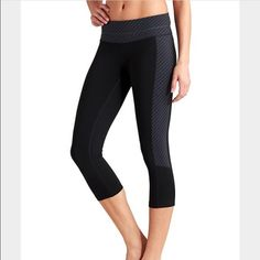 Athleta Zippy Balance Capri Smooth, wicking printed PIlayo in ruched Capri with utterly flattering unpinchable waistband. Black with grey stripes. In great condition. Athleta Pants