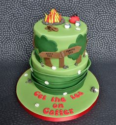 Campfire Birthday Cake. Hill walker cake with fire, kettle and mugs of tea. Based on the Lomond Hills in Fife, with signs for Maspie Den, Arity Den, Pillars of Hercules and the Temple of Decision. Put the tea on Gaffer is a saying from my dads childhood. Pam Bakes Cakes, pambakescakes.