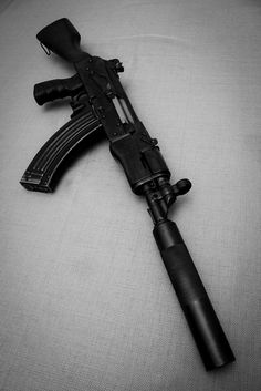 """AK47 7.62x39mm, """"suppressed"""" with H type iron sights."""