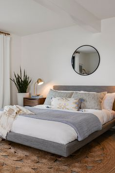 Modern, minimal, but still cozy. The Tessu upholstered bed is covered with a linen-feel polyester fabric blend, lightly stuffed for maximum comfort. Light Gray Bedroom, Bedding Master Bedroom, Modern Master Bedroom, Grey Bedding, Cozy Bedroom, Modern Bedroom Lighting, Serene Bedroom, Minimal Bedroom, Neutral Bedrooms