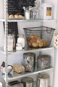 Kitchen Organization: glass jars, metal baskets, metal tins