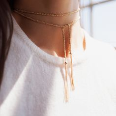Upping the everything levels of your look. Two delicate 14k gold filled chains braided with lustrous colored thread. Era can be wrapped around the neck and tied