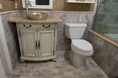 @Tile Outlets of America - Silver Travertine bathroom remodel in Florida @Coverings Trade Show #Coverings25