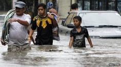 Residents wade on a flooded street in Las Pinas, Metro Manila 7 August, 2012 7 August, Manila, Philippines, Couple Photos, Street, Couples, World, People, The World