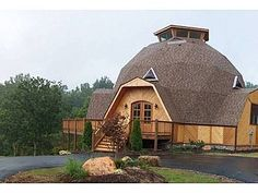 Dome House with 30' ceilings, marble gas fireplace,oak, walnut, tile and frieze carpet flooring.
