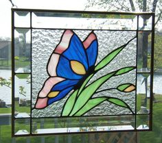 Stained glass panel butterfly blue on leaves stained glass window panel flower. Stained Glass Flowers, Faux Stained Glass, Stained Glass Designs, Stained Glass Panels, Stained Glass Projects, Stained Glass Patterns, Glass Butterfly, Blue Butterfly, Butterfly Pattern