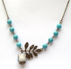 Antiqued Brass Leaf Turquoise Porcelain Owl Necklace: she has so many beautiful necklaces! I want them all!