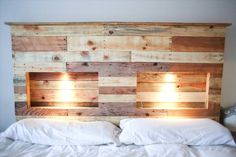 A cool headboard made from recycled pallets and with integrated lights!…