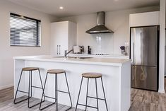 Kitchen Design | Christchurch Show Home | Breakfast Bar | White Kitchen Kitchen Layout, Kitchen Design, Kitchen Inspiration, Design Inspiration, Homes, Bar, Breakfast, Table, Furniture
