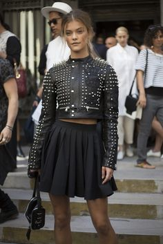 #SS16 #NYFW Street Style - The rockers' style was recognizable one feature being motorcyle like leather jackets sometimes featuring badges and studs
