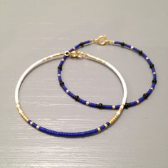 Tiny Delicate Bracelet , Layering Beaded Bracelet made of Seed Beads  This listing is for one beaded gold fill Bracelet in BLUE WHITE AND GOLD