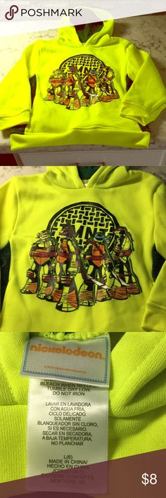 TNMNT. HOODED SWEATSHIRT. Super Cute ! Neon yellow with graphic and turtle shell accent at sides. Like new. Nickelodeon Shirts & Tops Sweatshirts & Hoodies