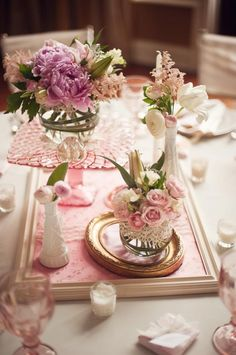 Wedding table centrepieces using pink glass cake stand. Rental price $20-30