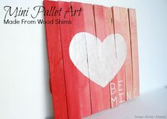 "Mini Pallet Valentine's Day Art by Design, Dining + Diapers  Great explanation for using wood shims to create the look of a wood ""pallet"" for use as art; I can see this used for lots of wood sign ideas"