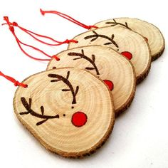 Rustic Christmas Tree Decoration made By Hand & Heart!  This listing is for four (4) wood burned and hand painted reindeer decoration.  Inspired by Rudolf, these beautiful and unique Christmas ornament have been burnt and painted by myself in my Athens studio.  -Each decoration is made entirely by hand on environmentally reclaimed wood.  The exact size of each wood slice will vary slightly, as I can not always source the same wood, but measures approximately 5,5 x 5 cm or 2 11⁄64 x 1 31⁄32…