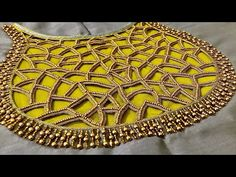 Here's a beautiful cut work blouse. This is a very easy embroidery at the same time a grand looking blouse Hope the video is useful for you all. Cutwork Blouse Designs, Embroidery Neck Designs, Cutwork Embroidery, Fancy Blouse Designs, Bridal Blouse Designs, Blouse Neck Designs, Golden Blouse Designs, Mirror Work Saree Blouse, Zardosi Work Blouse