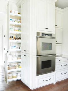 Pullout Pantry - Keep ingredients and cooking staples at the ready with handy pullout units. A slender but deep gap behind these wall ovens could have been lost space, but the pullouts make the most of the awkward space and bring the cabinet contents into full view.