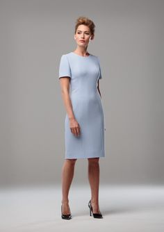 PALE BLUE WOOL CREPE SHIFT DRESS A short sleeved shift dress in pale blue single wool crepe. The dress is available in a variety of colours. Also shown with a loosely fitting tweed single button jacket in shades of pale blue, brown and black.