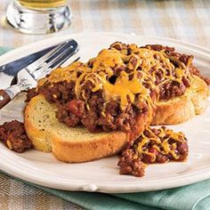 Add cheese and barbecue sauce to the ground beef in a traditional sloppy joe mixture and serve over Texas toast for an easy, family-friendly main dish meal.