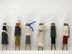 Wooden clothes pegs, fabric, pipe cleaners, crayons - we made whole families from Mum's pegs