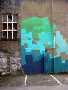 street art by nuria mora. Colour brought to neglected buildings...