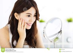 Happy Young Woman Looking On Mirror Stock Photo - Image: 58316407