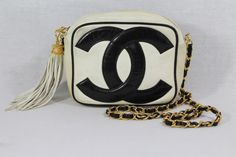 "Vintage Black & White Chanel Double C Logo Bag/Purse with Tassel/Fringe Unbelievably rare leather bag with black and gold chain. Chanel black and white bag with statement size interlocking C. An iconic and collectable piece. Logo C's are stitched individually on the front AND the back of the bag! Zip closure with tassel,   ""Chanel""  ""Made in Italy"" stamped in gold in interior. This bag includes Authenticity card. Serial number is within interior pocket. Available at Cat Apolinar Vintage"