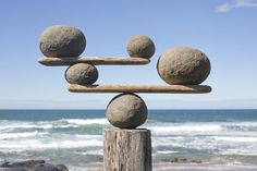 An poster sized print, approx (other products available) - Rocks balancing on driftwood, sea in background - Image supplied by Fine Art Storehouse - poster sized print mm) made in Australia Stone Sculpture, Metal Sculptures, Land Art, Landscape Edging Stone, Stone Balancing, Art Environnemental, Arte Alien, Art Pierre, Deco Nature