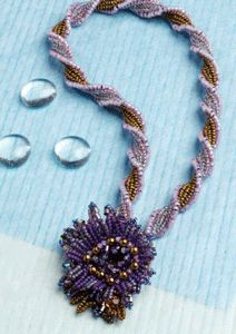 This is one herringbone stitch beading project you have to try. Have fun playing with the subtle twists and turns of the twisted herringbone strap for this beaded necklace.
