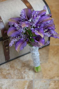 I love this...it seems so feminine. Real Touch Purple Calla Lily Wedding Bouquet - Purple Gray and Silver.