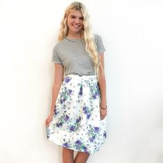 white and black striped shirt and white and blue floral skirt