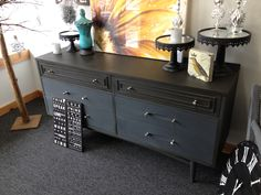 This piece is done in all Graphite Chalk Paint® decorative paint by Annie Sloan.  The top and two top drawer were dark waxed and the bottom four drawers were clear waxed.  Very modern looking!