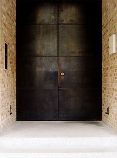 dark bronze paneled door