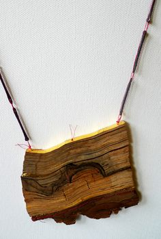 SINA EMRICH-DE-Necklace: Between the lines 2013-Wood, gold, nails, thread10 x 11 x 0,7 cm  length: 90 cm