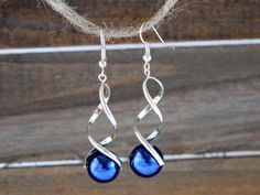 Silver and Blue Twist Dangle Earrings / Snow by NewEnglandEarrings #fashionbloggers #fallfashion #fashionista #jewelryinspo #jewelrymaking