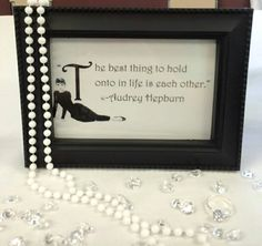 "Audrey Hepburn quotes as part of the center pieces for a ""Breakfast at Tiffany's"" themed bridal shower."