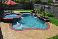 This small pool and spa in Katy Tx (Houston, TX) features stamped overlay…