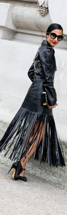Paris Fashion Week street style: fringe leather skirt and a embroidered leather jacket with pumps and oversized sunglasses