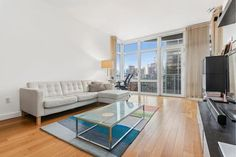 Learn more about this 1 Bedroom Condo for rent on West Street in Lincoln Square - make an appointment with one of our realtors today! Manhattan Real Estate, Indoor Basketball Court, Bike Room, Lincoln Square, Condos For Rent, Treatment Rooms, Outdoor Playground, Spacious Living Room, Ceiling Windows