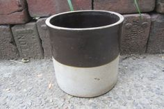 Stoneware crock. Great for country primitive decor. These look beautiful with dried flower arrangements or utensils storage.Guaranteed