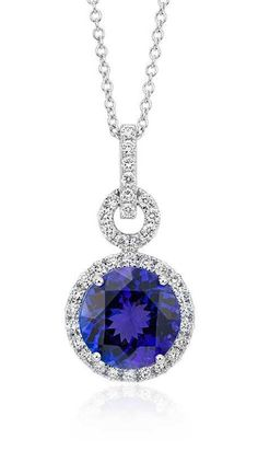 Brilliance color is captured in this stunning pendant featuring a round faceted tanzanite gemstone framed by sparkling round diamonds.