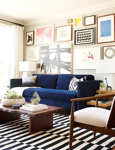 15 Lovely Living Room Designs with Blue Accents Navy sofa Printed