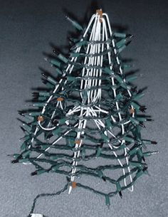 mini christmas tree using 6 wire hangers, lights, garland, craft pipe cleaners, and glue gun. ¤♡¤ I also saw that you can use a tomato vine-wire-thingie too! Hanger Christmas Tree, Diy Christmas Gifts For Family, Christmas Tree Crafts, Mini Christmas Tree, Homemade Christmas, Christmas Projects, All Things Christmas, Holiday Crafts, Christmas Wreaths
