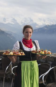 Picture of a costumed server with trays of hors d'oeuvres, Harder Kulm, Interlaken, Switzerland