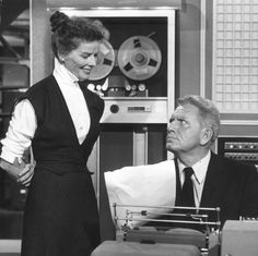 "Katherine Hepburn and Spencer Tracy in DESK SET (1957). Featured behind them is the film's ""EMERAC"" computer, based on the UNIVAC."