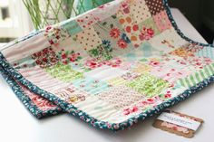 nanaCompany: scrap quilt baby sleep mat, this quilt is sized to fit in a bassinet, made from scraps, how sweet